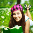 Stockfoto: Pretty girl reading a book