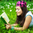 Pretty girl reading a book - Stock Photo