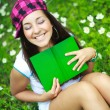 Happy girl reading a book — Stock Photo #1941402