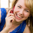 Laughing girl with a cell-phone — Stock Photo