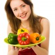 Beautiful happy woman with peppers — Stock Photo