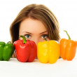 Pretty girl with peppers — Stock Photo