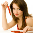 Sexy yougn woman with chili peppers — Stock Photo