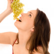 Young woman eating grapes — Stock Photo #1943576