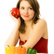 Beautiful dreamy woman with colorful peppers — Stock Photo