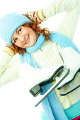 Cheerful girl goes ice-skating — Stock Photo