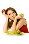 Beautiful woman unwilling to eat fruit — Stock Photo