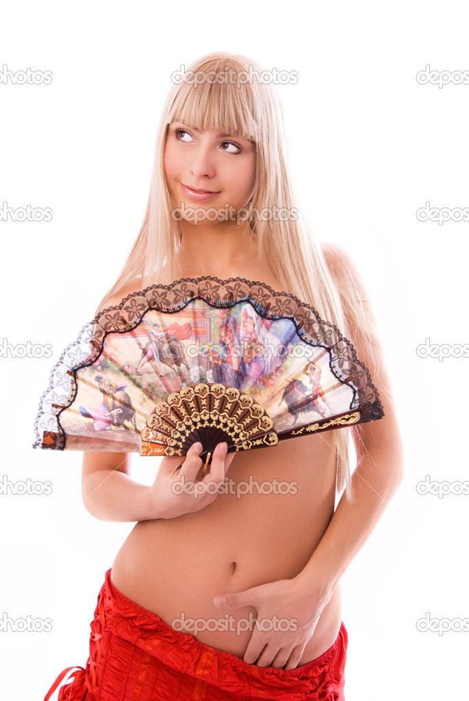 Beautiful topless dancer with a fan isolated against white background — Stock Photo #1940872