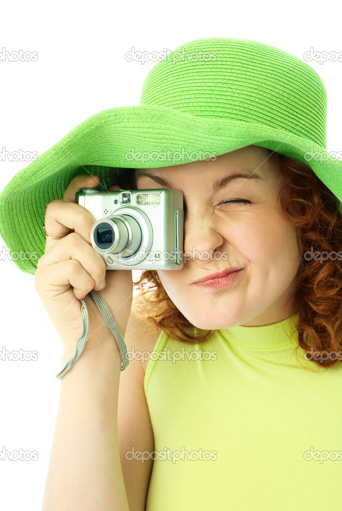 Enthusiastic young woman wearing a green summer hat with a camera  Stock Photo #1941117