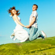 Jumping couple — Stock Photo