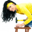 Beautiful woman with a hammer — Stock Photo