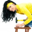 Beautiful woman with a hammer — Stock Photo #1985740
