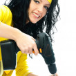 Beautiful young woman with a drill — Stock Photo