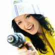 Excited young woman with a drill — Stock Photo #1986215