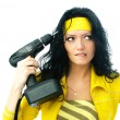 Beautiful woman with a drill — Stock Photo