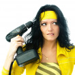 Beautiful woman with a drill - Stock Photo