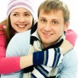 Happy couple dressed in winter clothes — Stock Photo