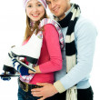 Happy young couple going ice-skating — Stock Photo
