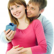 A young man gives a present to his wife — Stock Photo