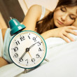 Sleeping woman with the alarm clock — Stock Photo #1989799