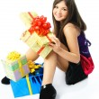 Happy girl with presents — Stock Photo