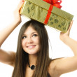 Pretty girl with a present — Stock Photo