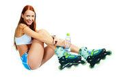 Glückliche Mädchen mit rollerskates — Stockfoto