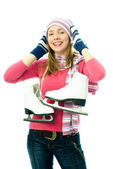 Beautiful young woman goes ice-skating — Stock Photo