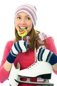 Beautiful girl goind ice-skating — Stockfoto