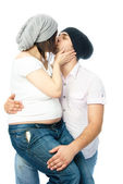 Pregnant woman and her husband kissing — Stock Photo