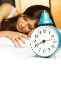 Sleeping girl with the alarm clock — Stock Photo