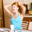 Laughing girl in the kitchen — Foto de Stock