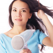 Woman with a hair-dryer - Photo