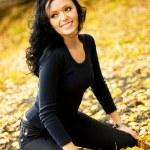 Pretty brunette girl outdoor — Stock Photo