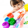 Cute girl painting with finger paints - Stock Photo