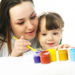 Mother and daughter painting with watercolor — Stock Photo