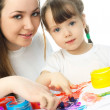 Mother and daughter painting with finger paints — Stock Photo #1995721