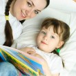 Mother and daughter reading a book — Stock Photo #1995847