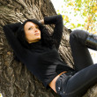 Стоковое фото: Beautiful sad girl on the tree