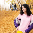 Beautiful young woman walking in the park — Stok fotoğraf