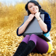Pretty girl with a laptop outdoor — Stock Photo