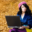 Dreamy girl with a laptop outdoor — Stock Photo #1996418