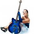 Sexy girl with a guitar — Stock Photo