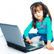 Little girl with a laptop — 图库照片