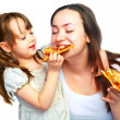 Mother and daughter eating pizza - Stock Photo