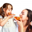Mother and daughter eating pizza — Stock Photo #1998862