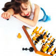 Girl playing chess — Stock Photo #1998910