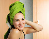 Beautiful woman with a towel on her head — Stock Photo