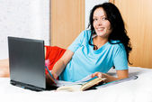 Girl with a laptop at home — Stock Photo