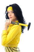 Brunette woman with a hammer — Stockfoto